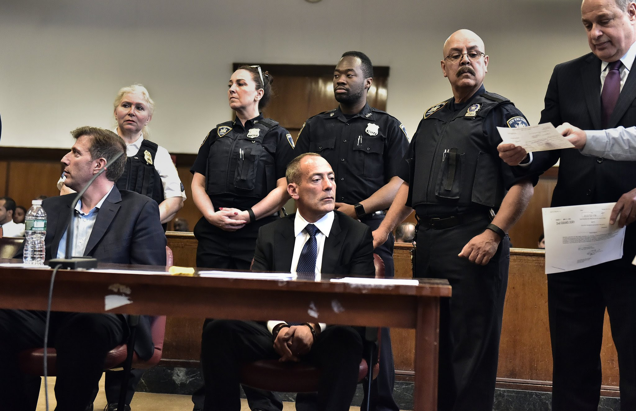 Steven Croman, center, and his mortgage broker, Barry Swartz, left, were arraigned at State Supreme Court on Monday.